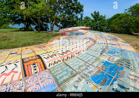 Milbi Wall or the Story Wall is Aboriginal art on ceramic tiles depicting the first known European contact at the spot where James Cook set foot in Co - Stock Image