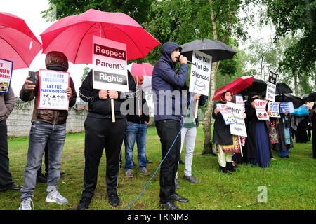 Birmingham, UK - Friday 7th June 2019 - Protesters chant near the Anderton Park Primary School in Birmingham in a protest against the No Outsiders education program - A High Court injunction is in force to prevent protesters gathering directly outside the school. Photo Steven May / Alamy Live News - Stock Image