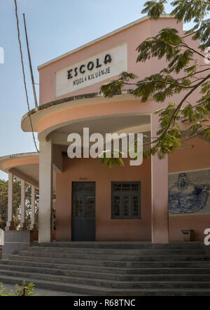 School in an Art Deco building with mosaic on the entrance wall, Benguela Province, Catumbela, Angola - Stock Image