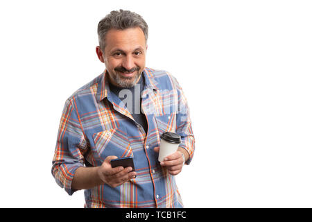 Smiling man holding smartphone and carton cup as coffee break concept isolated on white background - Stock Image