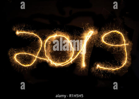 2019 , New Years Eve, Light painting, Black Background - Stock Image