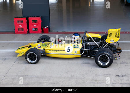 Roger Bevan driving his yellow, 1971, Lotus 69, during the media/test   day of the 2019 Silverstone Classic. - Stock Image