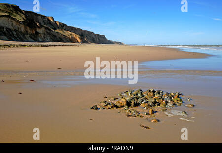 A view westwards along the beach at the North Norfolk coastal village of East Runton, Norfolk, England, United Kingdom, Europe. - Stock Image