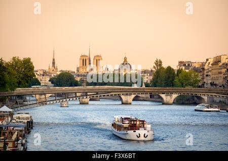 Seine River in Paris with Passerelle de Solferino bridge. In the distance, Notre Dame Cathedral and Institut de - Stock Image