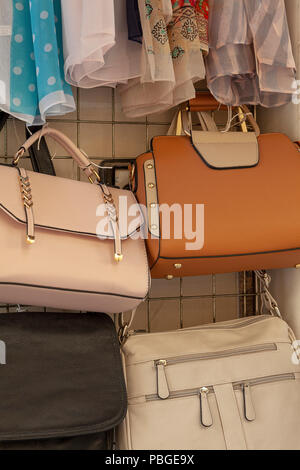 New Handbags for sale outside a store - Stock Image
