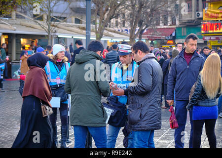 Istanbul, Turkey. Thousands wait in line to buy ticket for the Turkish national lottery's New Year's eve draw some waiting over 3 hours from the Nimet Abla in Eminonu Square, an annual tradition due to believed lucky nature of the establishment.  This leads to many other sellers setting up in the square, but most still prefer to wait in line at the famed kiosk. - Stock Image