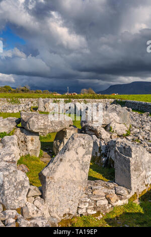 Ancient Creevykeel Court Tomb is located on the foothills of Tievebaun Mountain close to the sea near Mullaghmore in County Sligo, Ireland. - Stock Image
