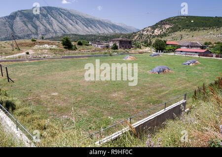 Haystacks in a football field Zagoria valley Albania - Stock Image