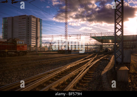 Railroad station sunset - Stock Image