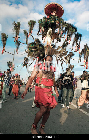 Kavadi bearer in procession during Thaipusam festival at Batu Caves in Selangor, Malaysia - Stock Image