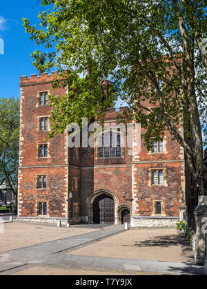 Lambeth Palace London lit in clear sunlight. Morton's Tower a red brick Tudor gatehouse forming the historic entrance to Lambeth Palace London UK - Stock Image