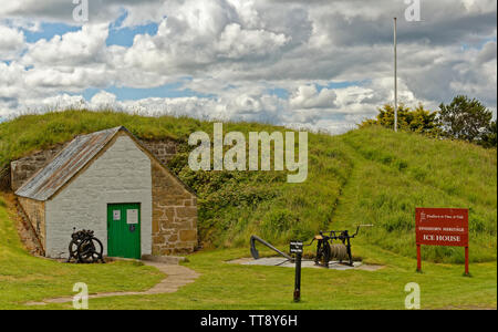 FINDHORN MORAY COAST SCOTLAND THE HERITAGE ICE HOUSE WITH A COLLECTION OF WINCHES AND AN ANCHOR - Stock Image