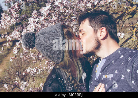 Lovely young couple having a good time together in spring - Stock Image