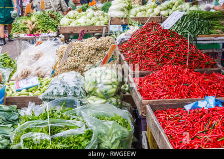 Market stall with vegetables and red chillies - Stock Image
