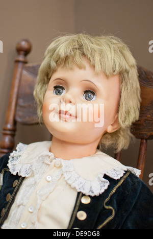 Antique child's doll in the Lincoln County Museum, Davenport, Washington State, USA. - Stock Image