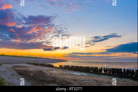 Beautiful sunset in Moddergat, The Netherlands, with Wadden Sea (Waddenzee). - Stock Image