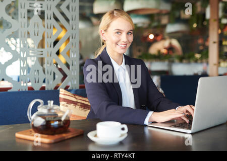 Young businesswoman in cafe - Stock Image