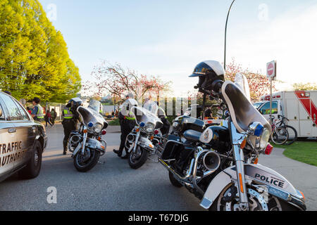 VANCOUVER, BC, CANADA - APR 20, 2019: VPD motorcycles and patrol vehicles at the 420 festival in Vancouver. - Stock Image