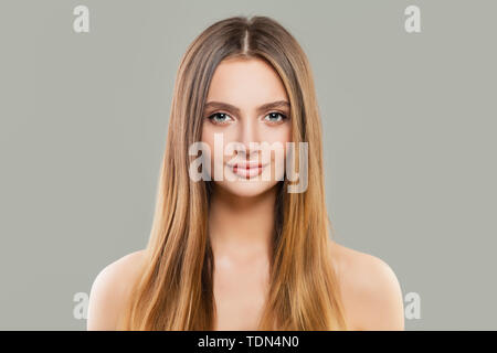 Healthy woman portrait. Beautiful model with clear skin and long shiny brown hair - Stock Image