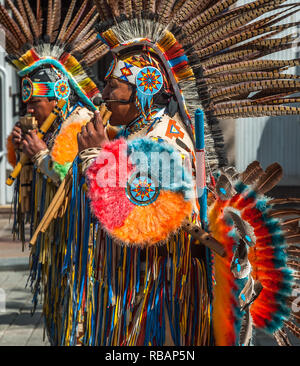 South American Pan Flute players performing in public in Keswick town centre, England, Uk. - Stock Image