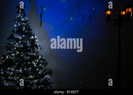 Festive background of christmas room with tree, lights, street lantern and blue stars - Stock Image