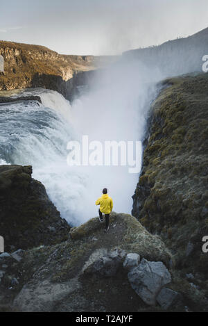 Hiker by Gullfoss waterfall in Iceland - Stock Image