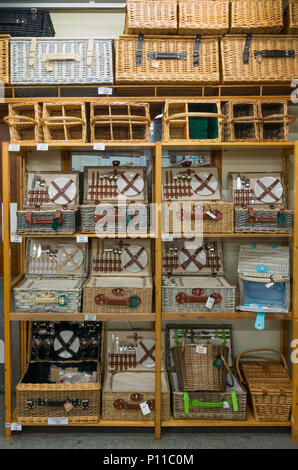 A display of fine picnic hampers for sale in a shop in North Yorkshire - Stock Image