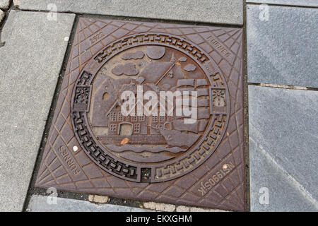 Decorated Drainage grate in Bergen, Norway - Stock Image