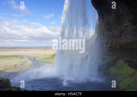 View over the plains from the path behind the Seljalandsfoss waterfall -Southern Iceland - Stock Image