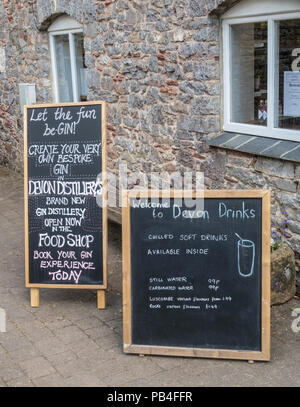 Devon Drinks sign, let the fun be gin, begin, at The Shops, a rustic retail park at Dartington. - Stock Image