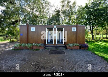 Outdoor,outside,countryside toilet block,male,female,Lake District,Cumbria,England UK - Stock Image