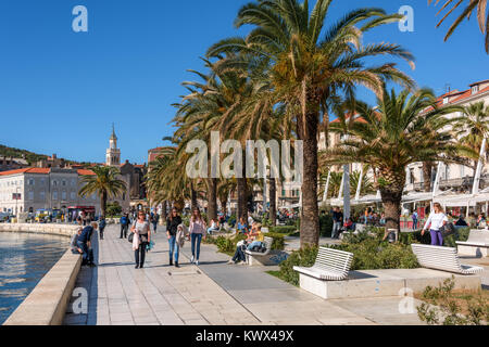 Tourists and locals enjoying Riva promenade, Split, Croatia - Stock Image