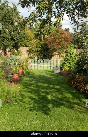 Wide grass path, Fulham Palace Gardens, London Borough of Fulham, England Britain UK - Stock Image