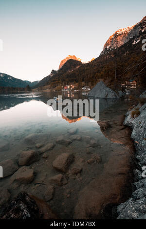 Amazing morning scenery on Hintersee Lake with alpine peaks reflected on the water. - Stock Image