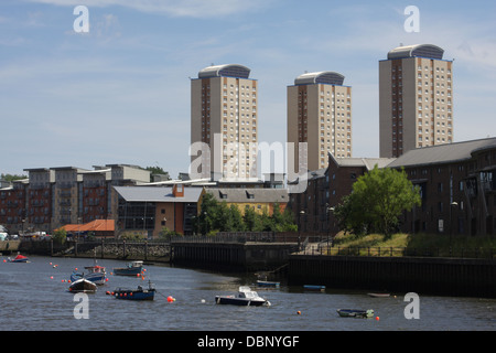 Fishing boats on the River Wear, Tower Blocks in Background. - Stock Image