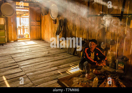 A Man in his kitchen in the countryside of Phongsali, Laos - Stock Image