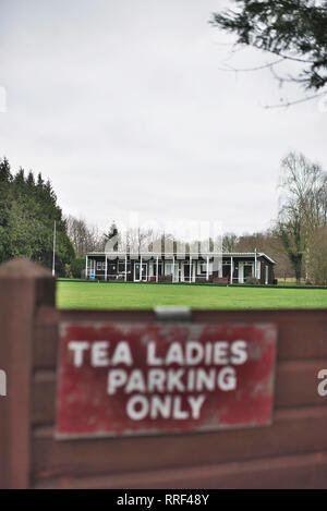 Tea ladies parking sign at a bowling green in a english village with a tea hut in the background - Stock Image
