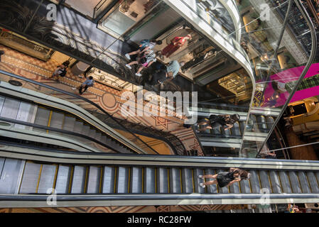 Looking down from the top floor of the Queen Victoria Building in central Sydney, New South Wales, Australia, on a complex arrangement of escalators - Stock Image