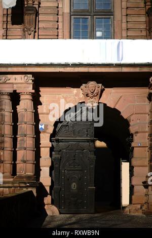 The heavy front door of castle Johannisburg in Aschaffenburg. - Stock Image