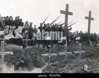 Firing squad from Company 'M' 339th Infantry firing a salute over the graves of American officers and men on memorial Day, Allied burial ground, Archangel, Russia ca. 5/30/1919 - Stock Image