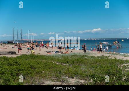 Beach at Espergærde, Espergaerde, near Elsinore on the coastal road to Copenhagen on the first summer day. - Stock Image