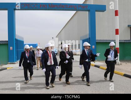Basra, Iraq. 23rd Apr, 2019. Photo taken on Feb. 27, 2019 shows officials from China Petroleum Engineering and Construction Corporation (CPECC) and Basrah Gas Company inspecting the plant in the southern province of Basra, Iraq. Through the Belt and Road Initiative, the Chinese company can offer financial, technical support and expertise for Iraqi government in reconstructing oil fields and increase their production, said Wang Xianghui, project director of Rumaila in China Petroleum Engineering and Construction Corporation (CPECC). Credit: Khalil Dawood/Xinhua/Alamy Live News - Stock Image
