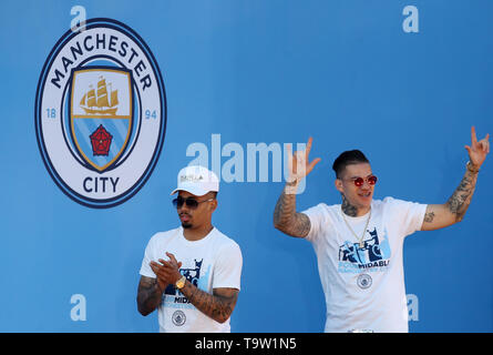 Manchester City's Gabriel Jesus and Ederson walk on stage during the trophy parade in Manchester. - Stock Image