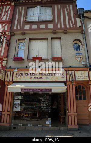 Exterior of boucherie / charcuterie shop in half timbered building in Grande Rue des Stuarts, Dol de Bretagne, Ille et Vilaine, Brittany, France - Stock Image