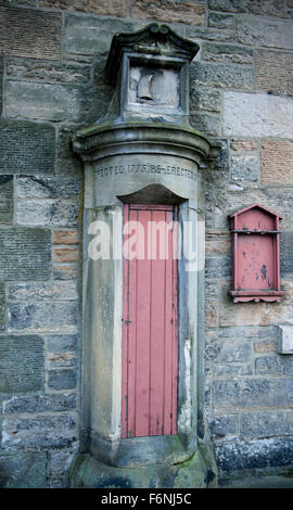 The Newhaven Harbour barometer located on the wall of the former Society of Free Fisherman building, Leith Edinburgh - Stock Image