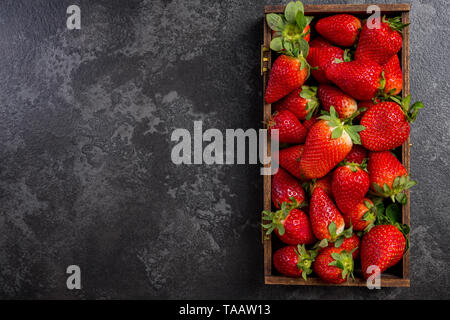 Wooden box with market fresh strawberries. - Stock Image