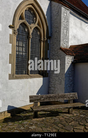 Bench for sitting outside St Mary the Virgin Church, Northolt village, Middlesex - Stock Image