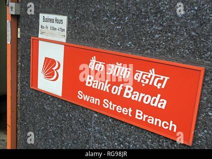 red sign, Bank of Baroda, Swan Street Manchester Branch BoB, England, UK - Stock Image