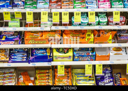 Miami Beach Florida CVS Pharmacy drugstore inside display sale candy bars chewing gum junk food Trident Reese's m&m's - Stock Image