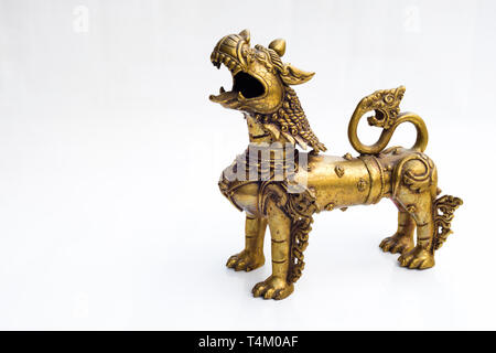 Iron statue of oriental dragon in white isolated background. - Stock Image